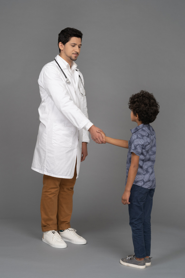 Doctor and child shaking hands