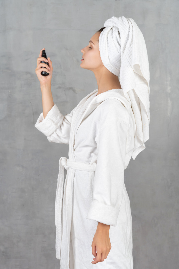 A woman in a white coat and a scarf