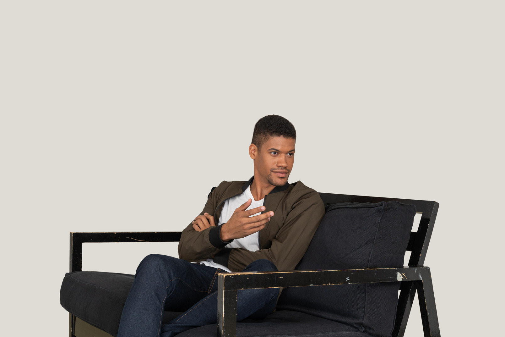 Young man sitting on the sofa and seems like telling something