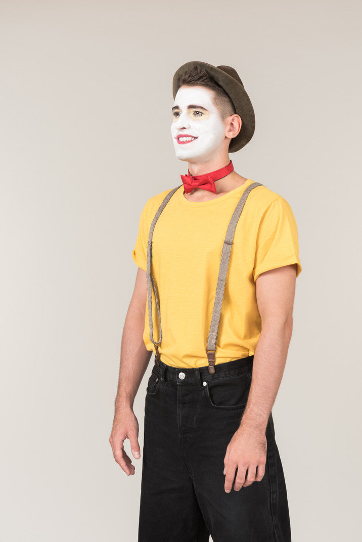 Male clown standing half sideways