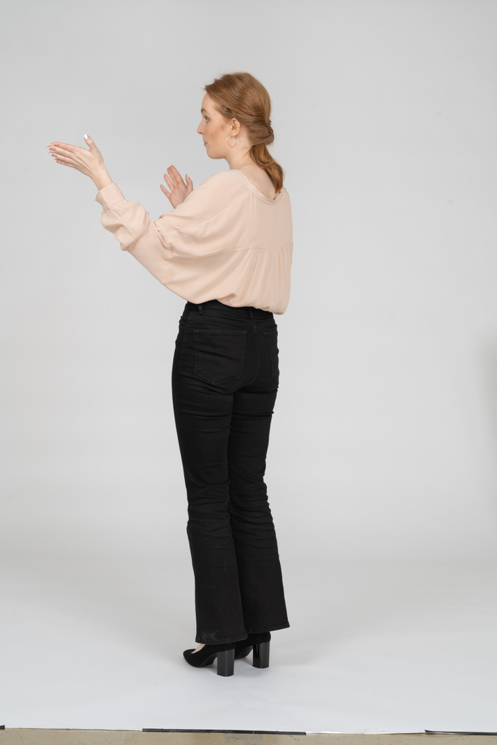 Woman in beautiful blouse standing