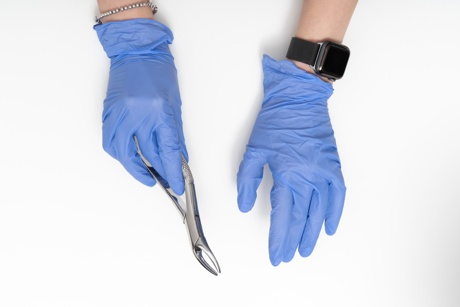A pair of blue gloves hanging on a rope