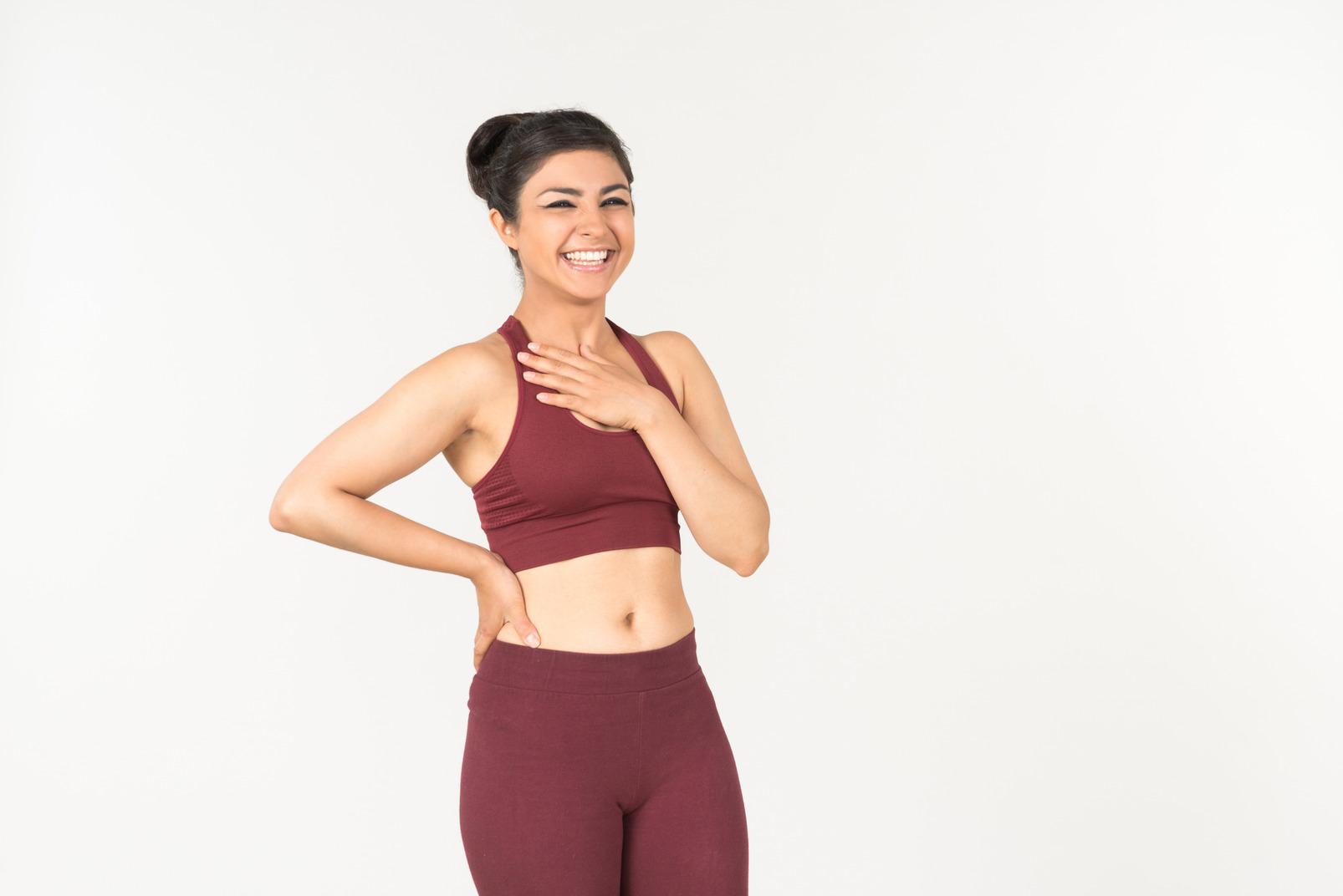 Indian girl in sporstwear checking fitness tracker