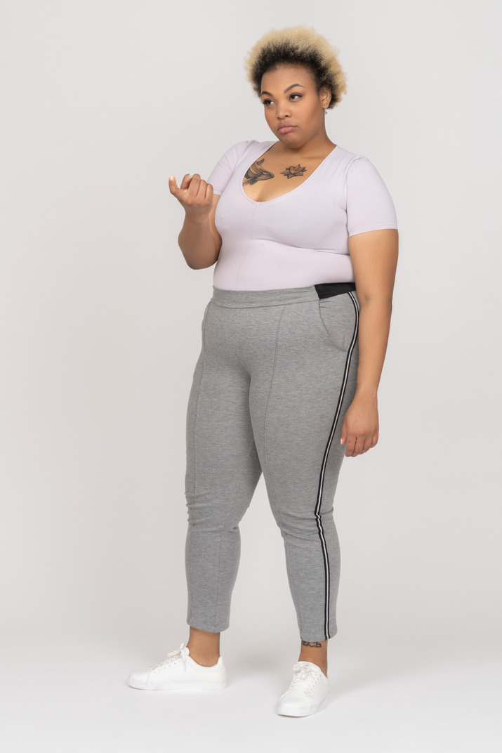 Body positive afro female beckoning with a finger