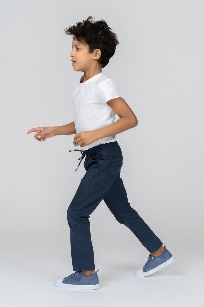 A boy running around