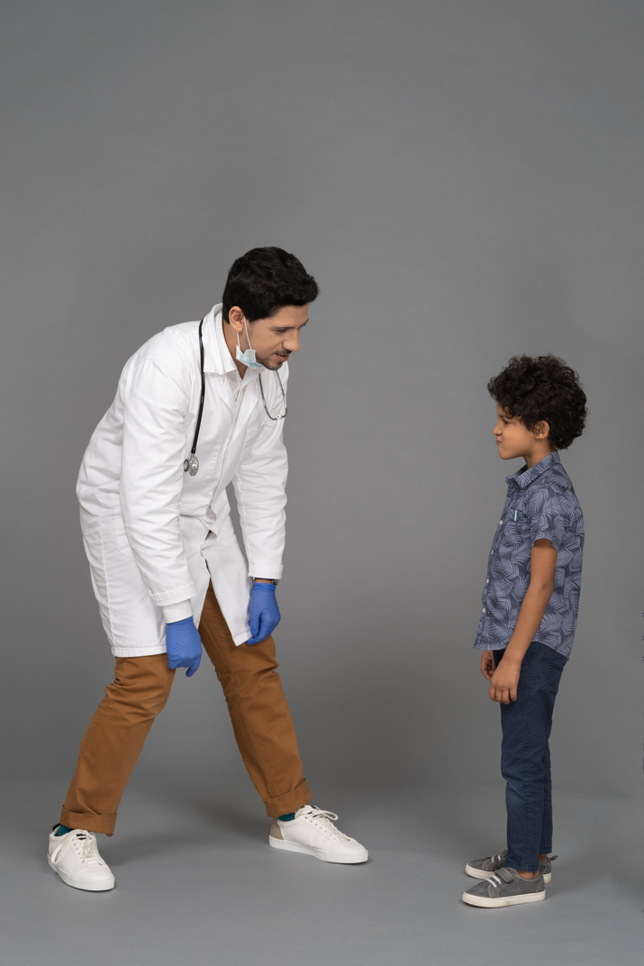 Doctor and boy looking at each other