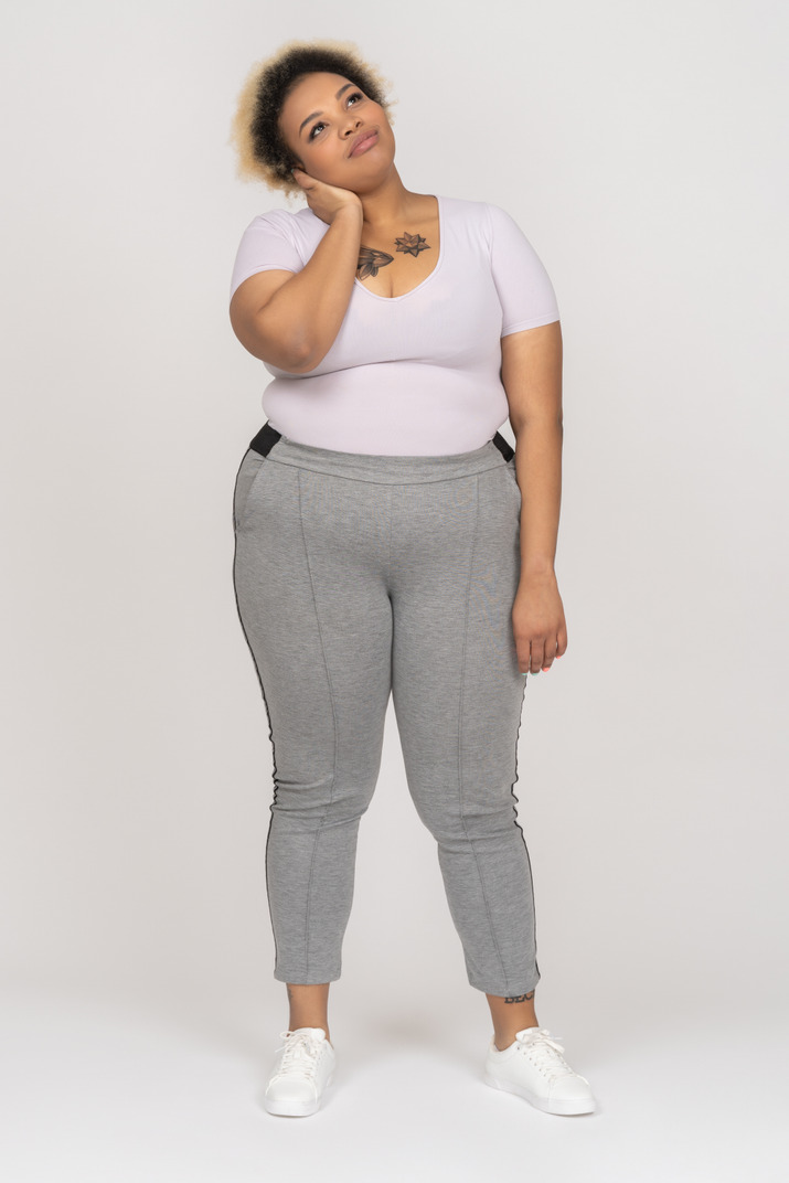 Delighted plus size woman daydreaming