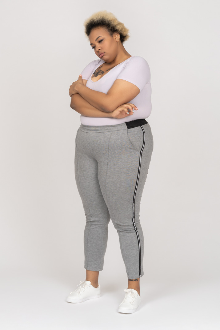 Offended dark skinned female posing with folded arms