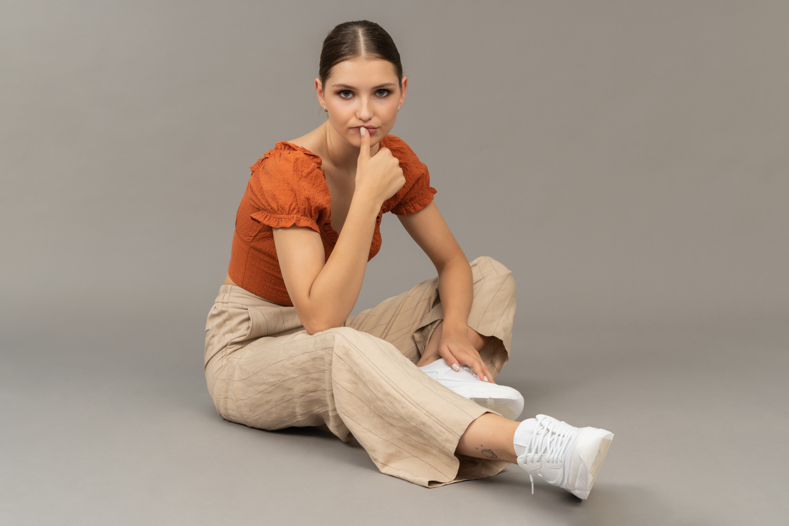 Young woman sits while thinking