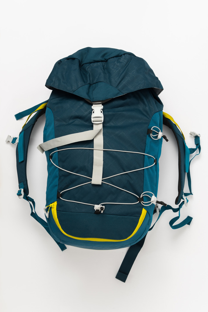 Blue tourist backpack on white background