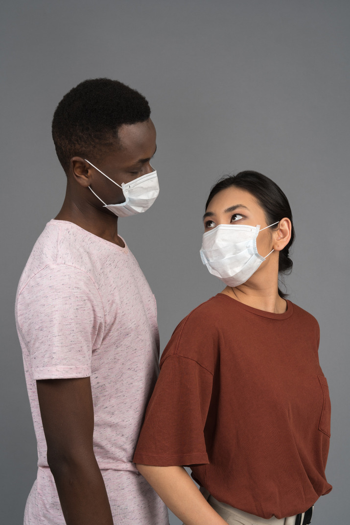 A young couple wearing medical masks