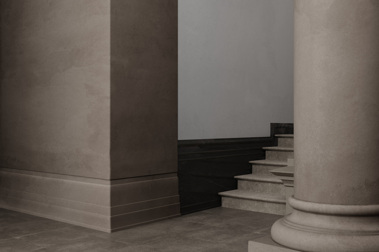 A thick old wall and a column near the stairs up