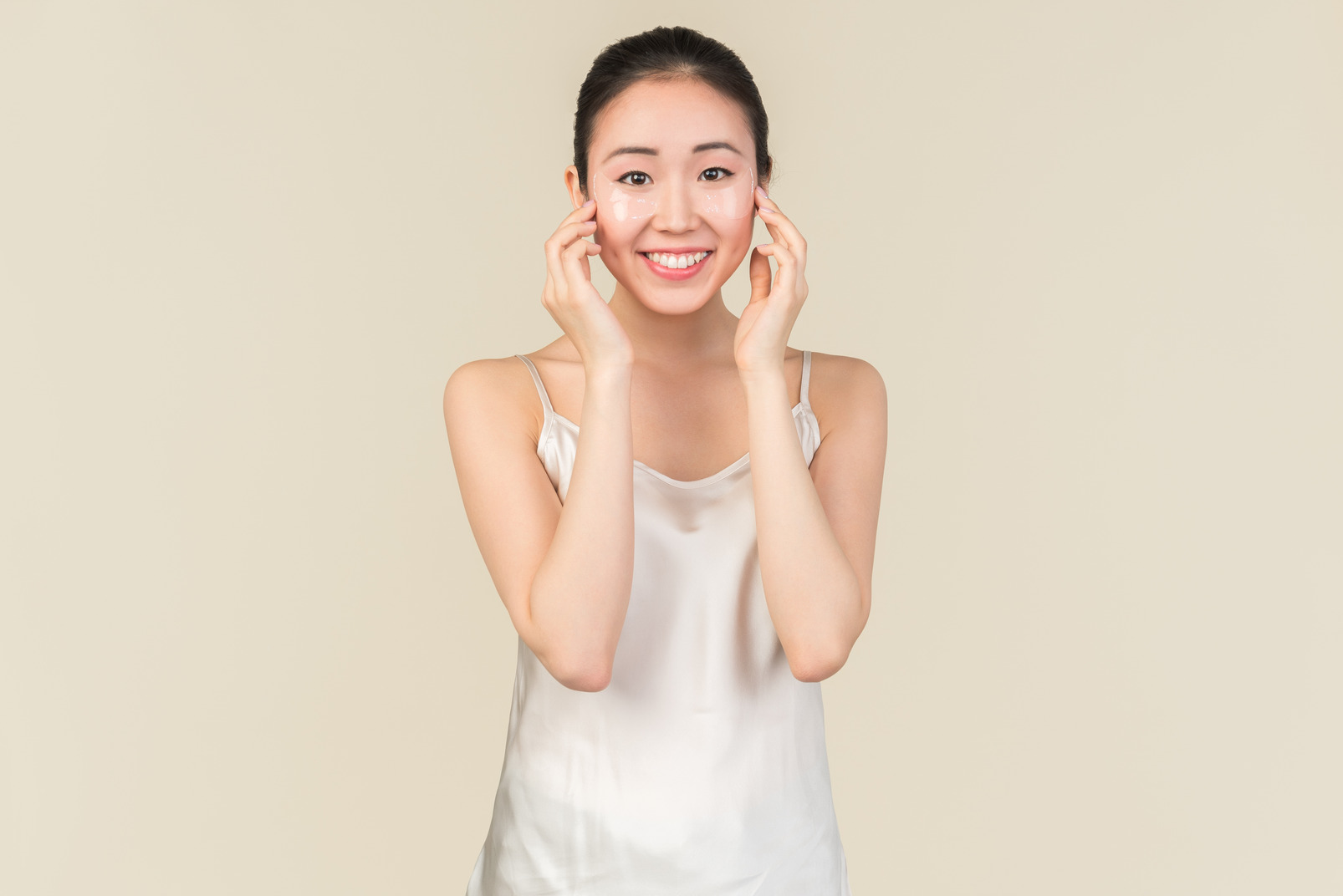 Young asian girl with eye patches on her face