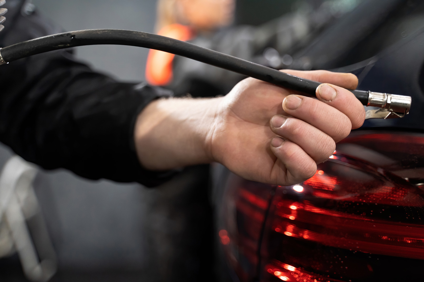 Human hand holding air pump hose