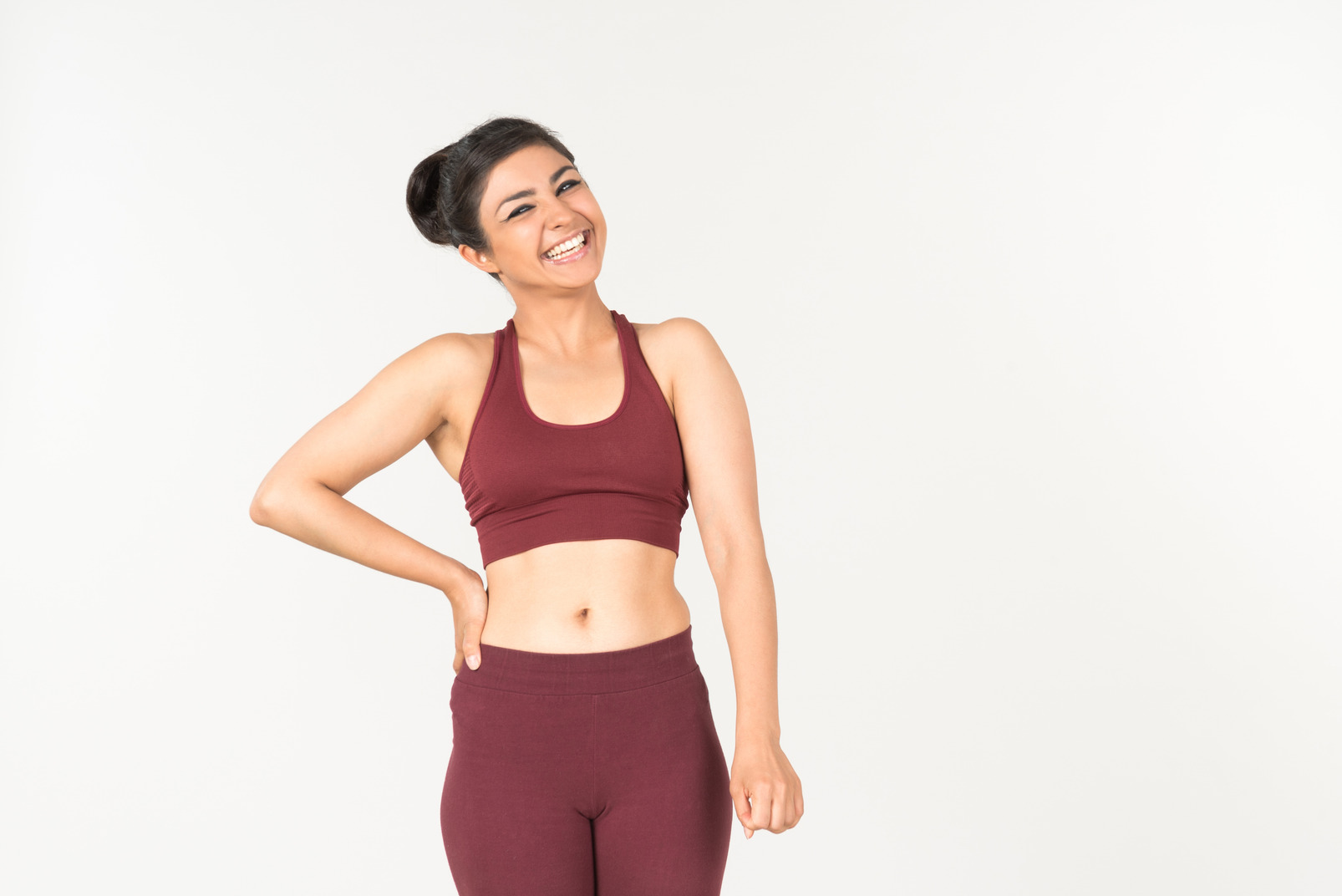 Laughing young indian girl in sportswear