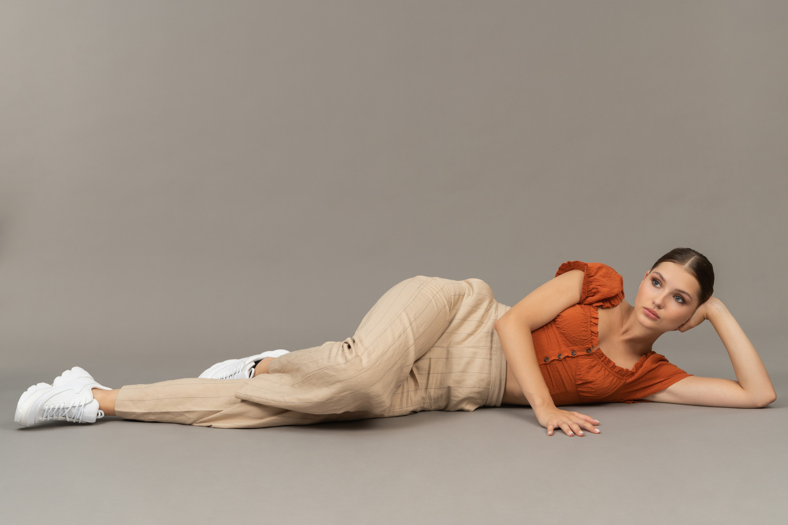 Young woman lying down on floor