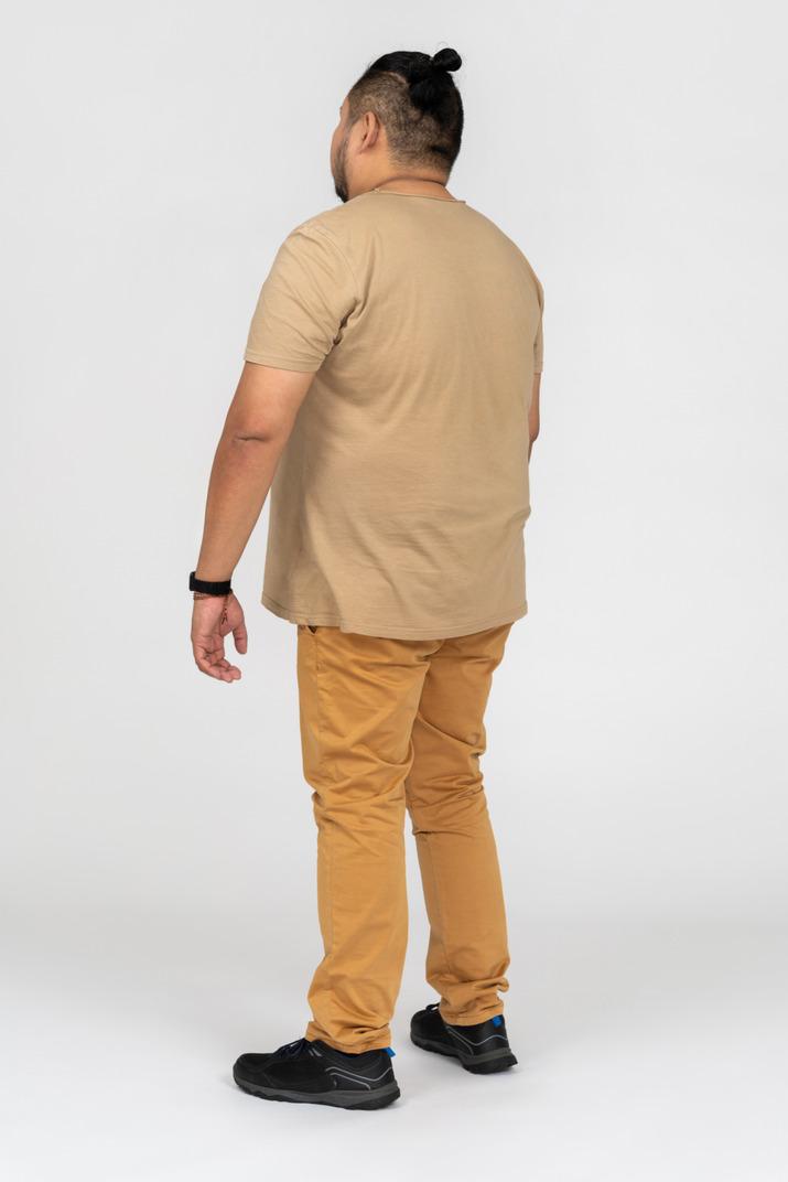 Young asian man standing still