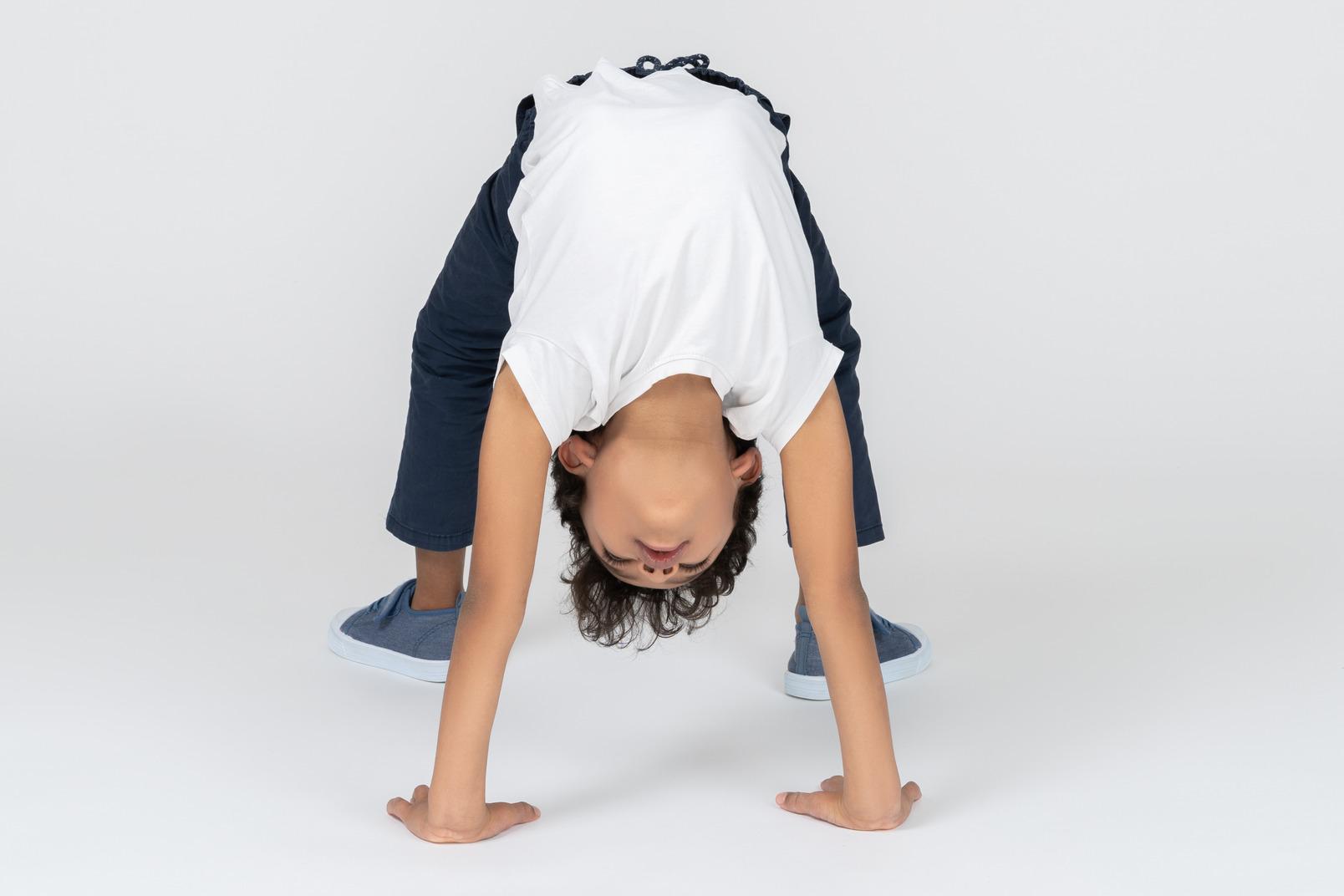 A boy doing bridge exercise