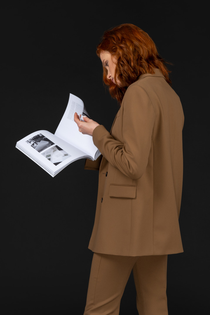 A woman looks at a book