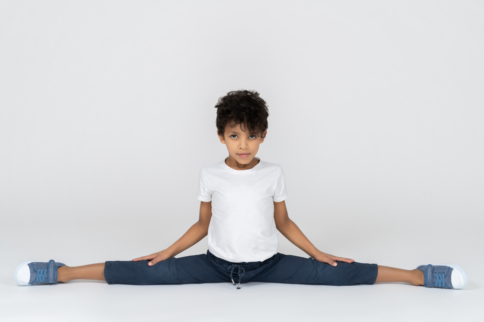 A boy doing split exercise