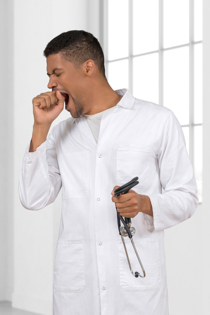 Tired doctor yawning