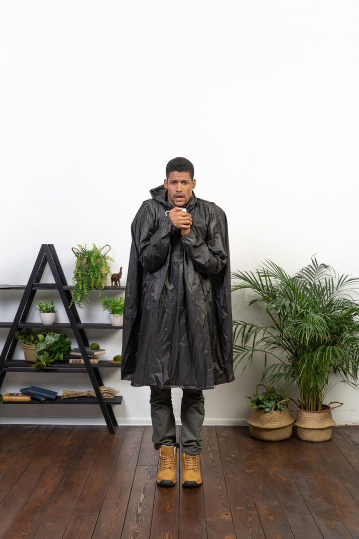 Good looking young man in the raincoat