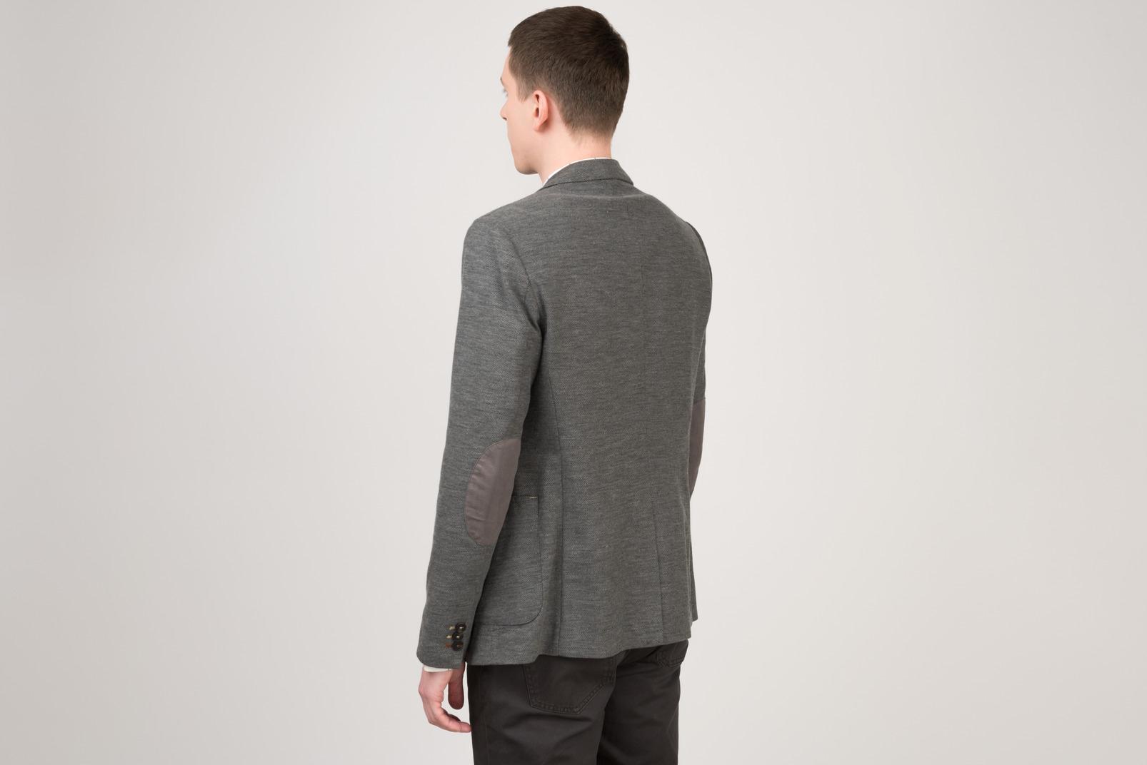 Young man standing half sideways