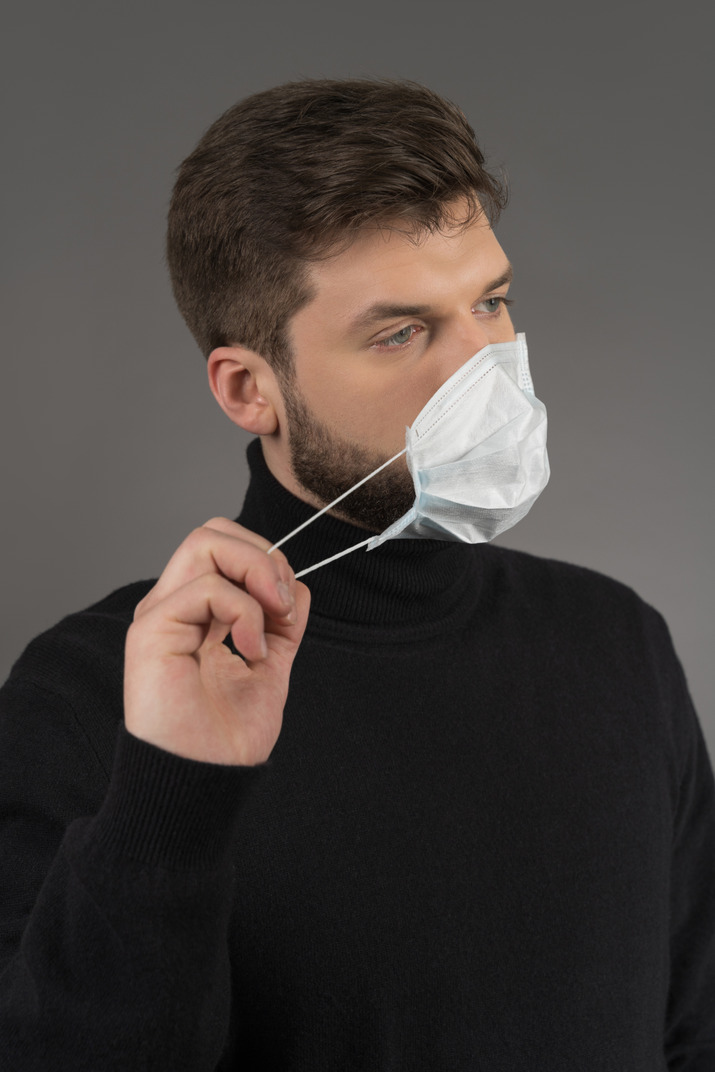 A man wearing a surgical mask