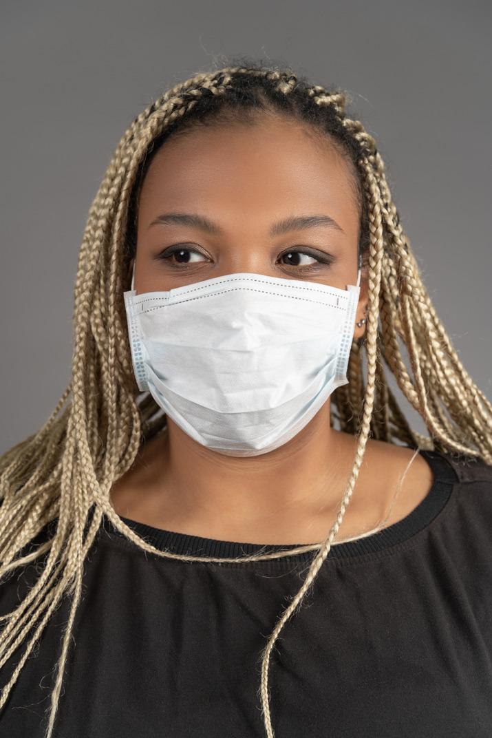 American woman wearing respiratory mask during coronovirus pandemic