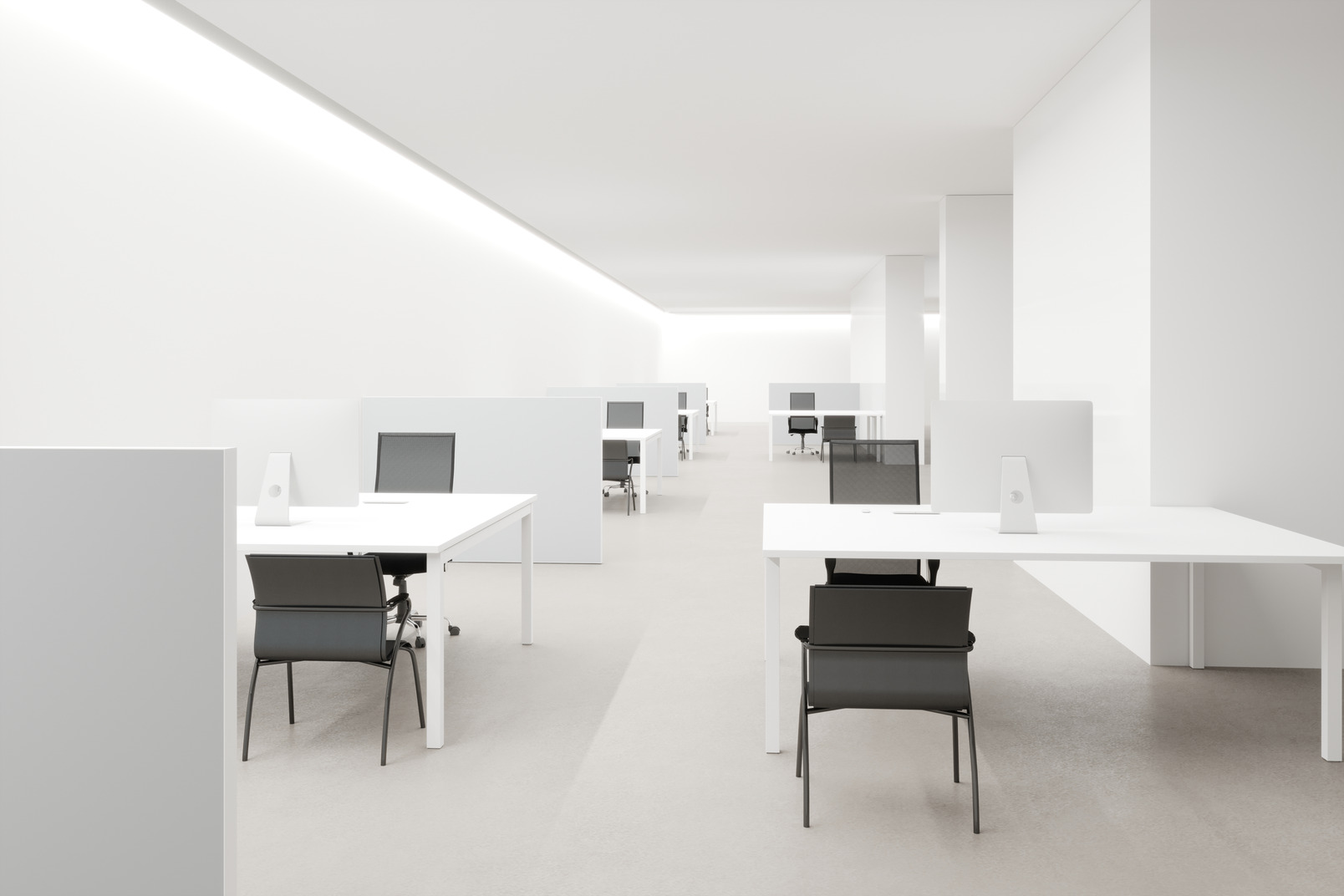 A clean white room for office workers, with cold lighting and computer desks in a row