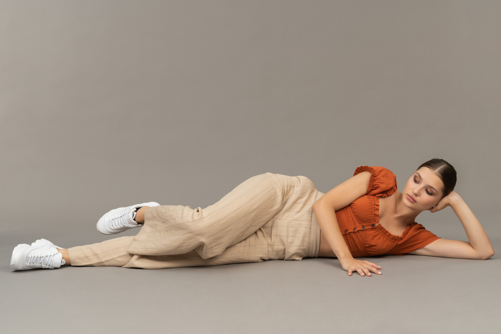 Young woman lying down and thinking
