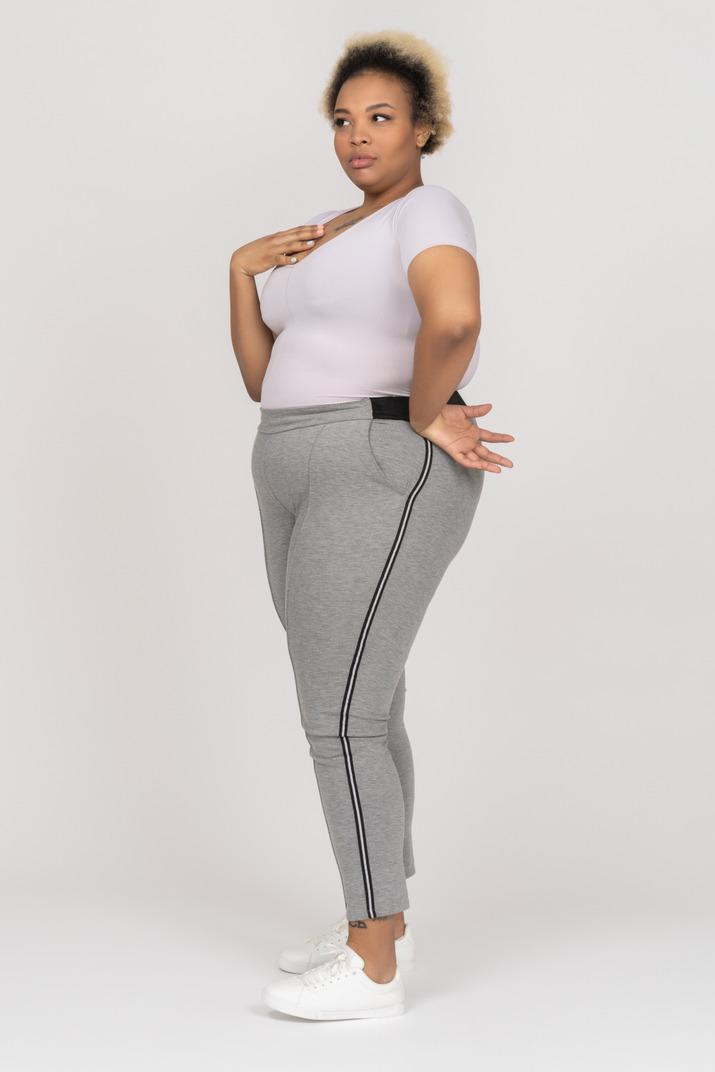 Plus size african-american woman looking surprised