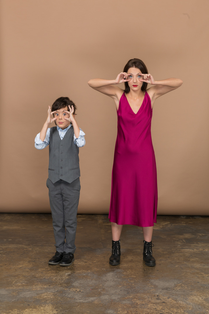 Young girl and a boy standing together