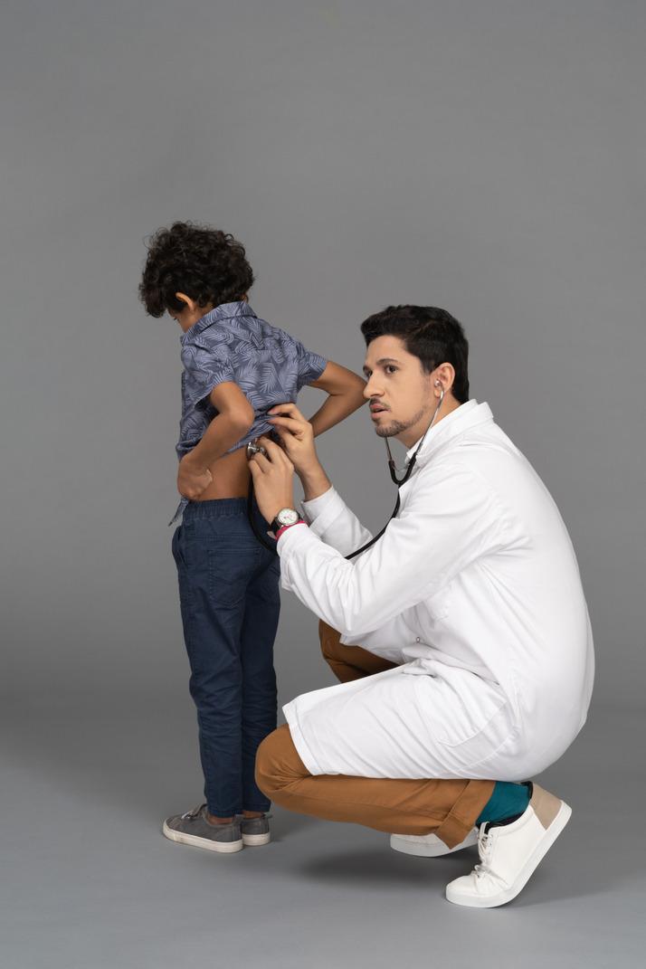 Doctor examining kid