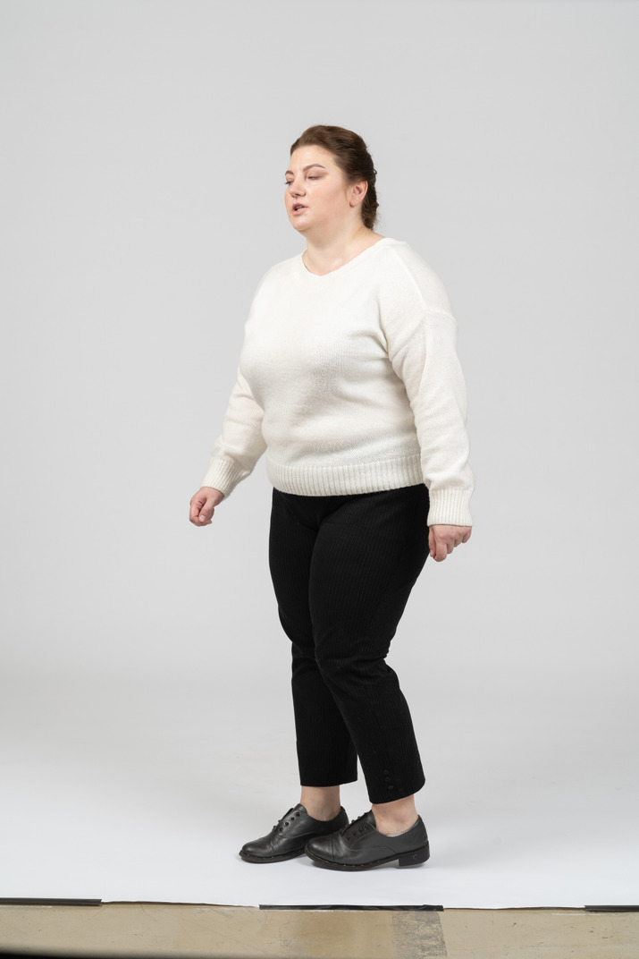 Side view of a plus size woman in casual clothes