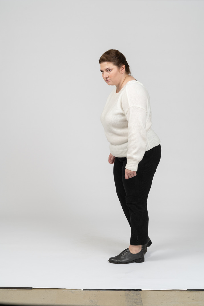 Side view of plump woman in casual clothes