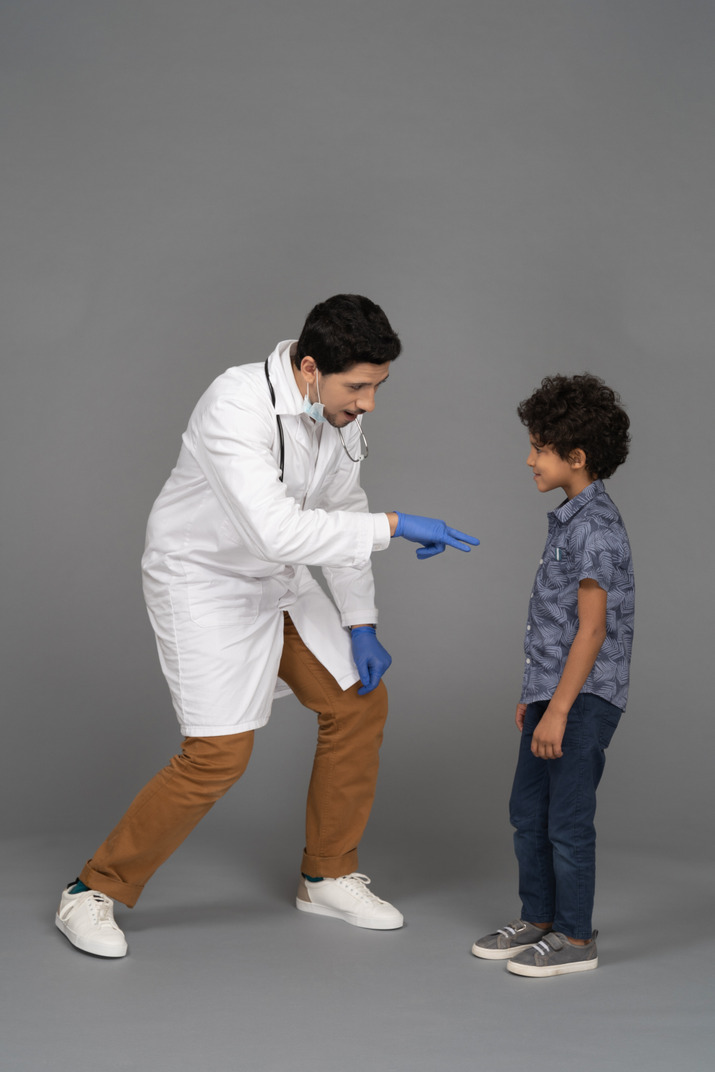 Doctor playing with boy