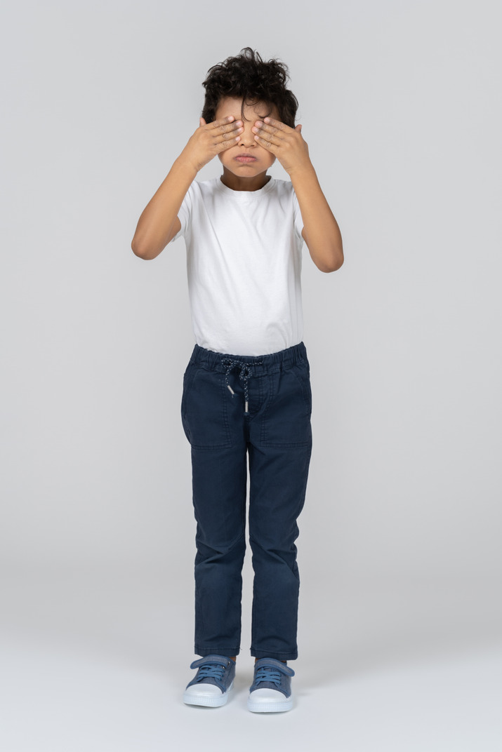 A boy playing hide and seek