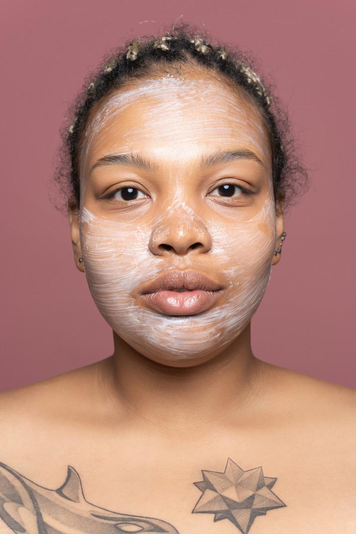 Woman using a face cream