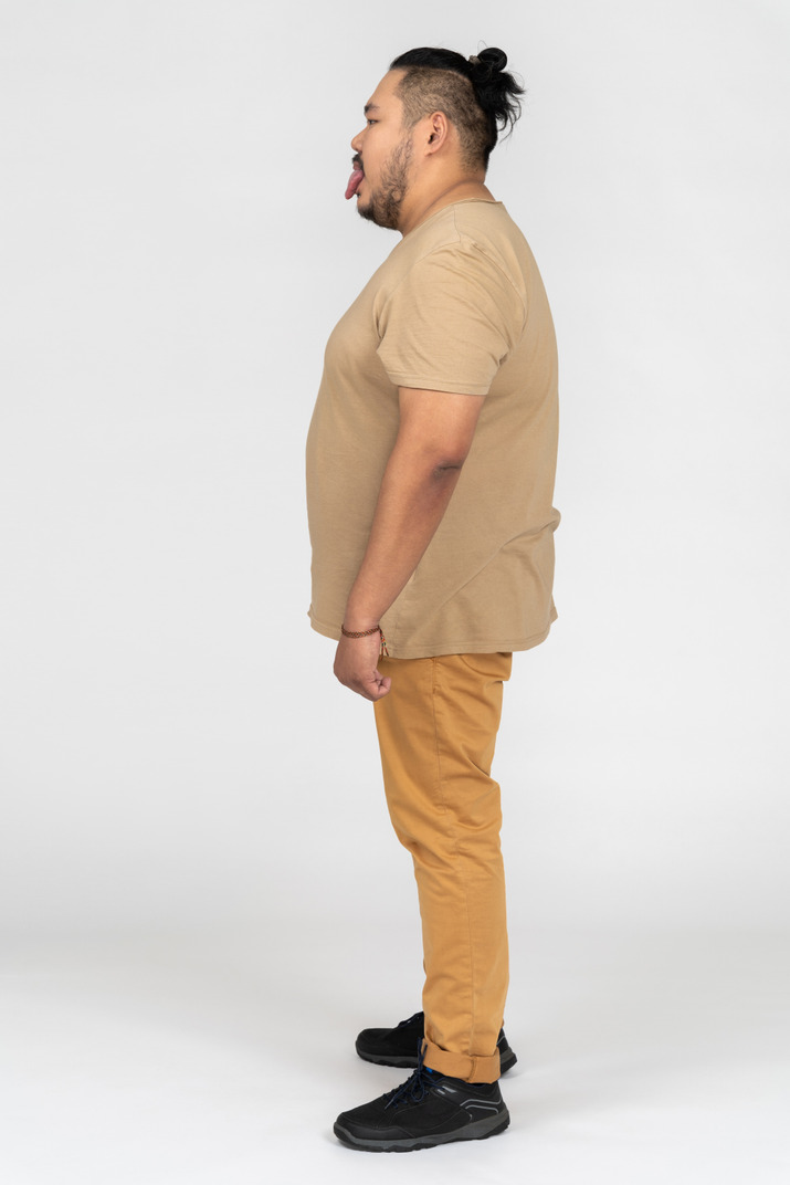 Young man standing sideways