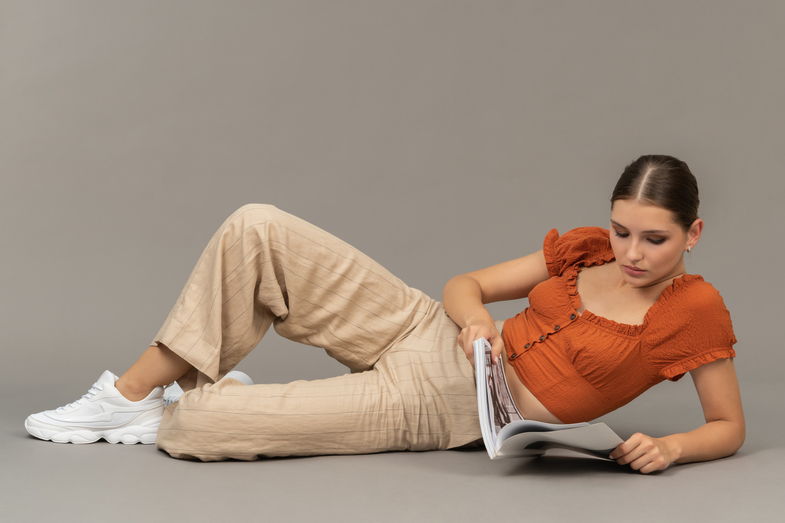 Young woman reading on the floor