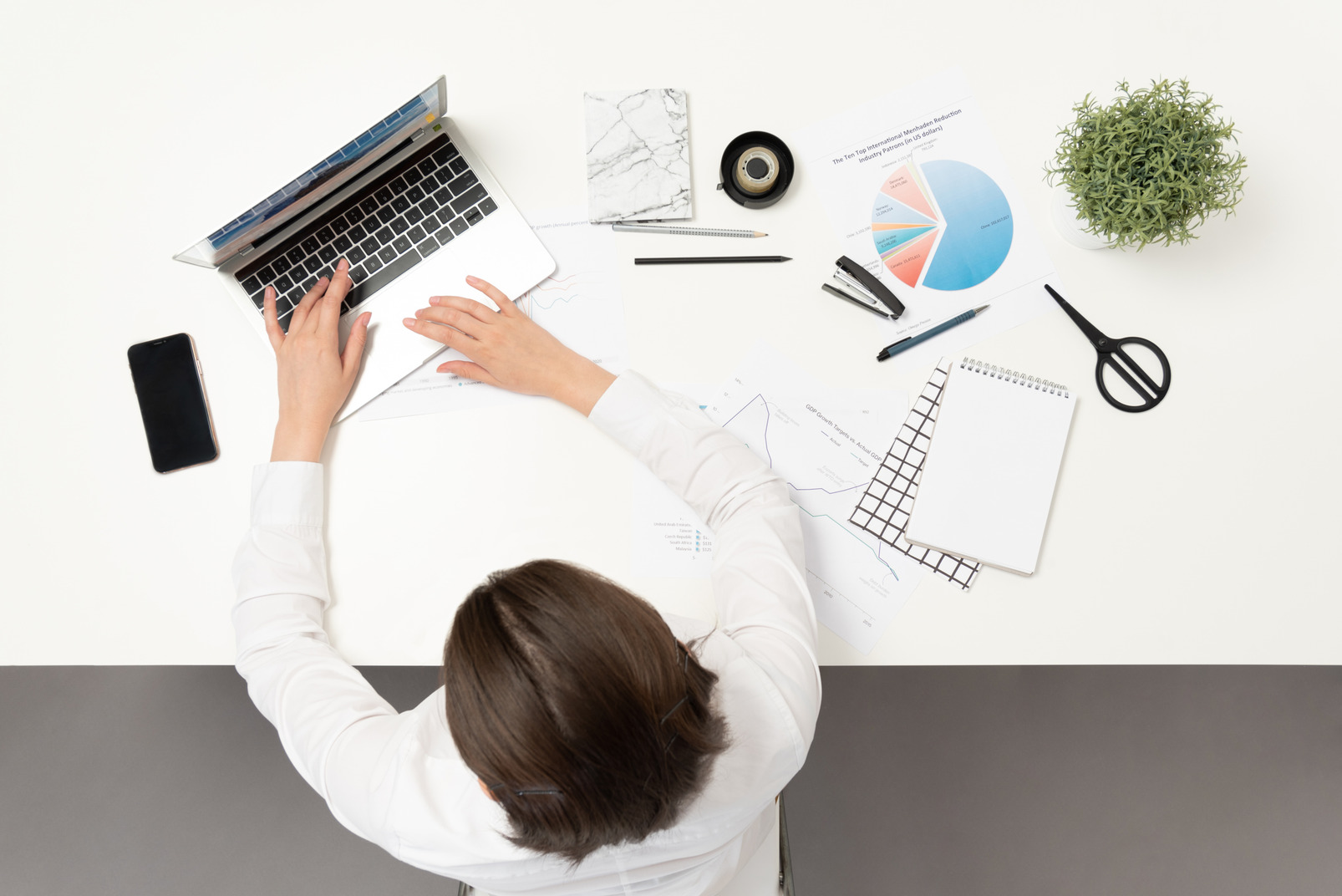 A female office worker typing at the table