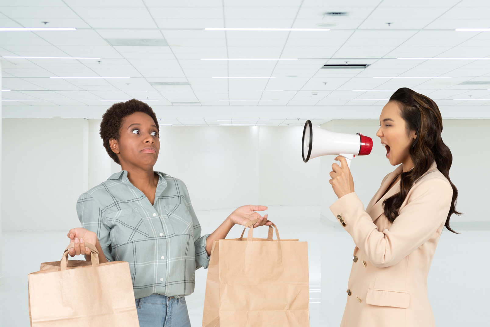 Female office employee yelling in megaphone at promoter