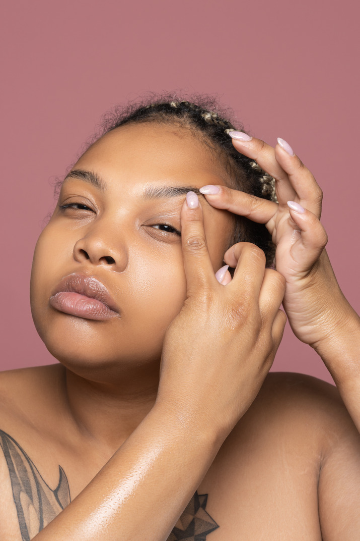 African-american woman observing signs of aging