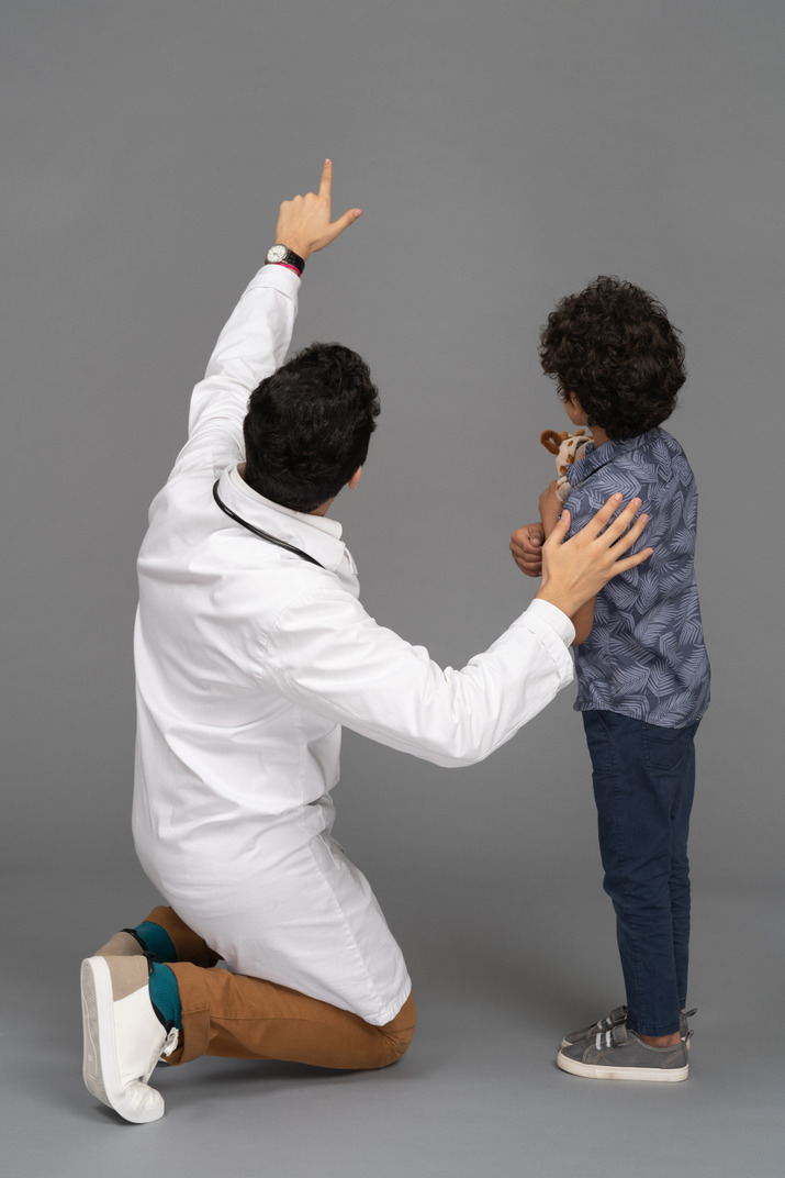 Doctor showing something to boy