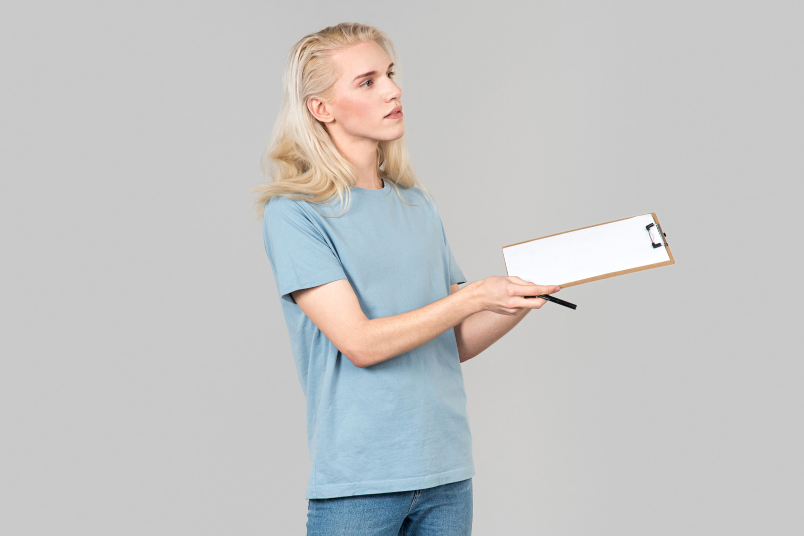 Young activist guy standing half sideways and holding folder