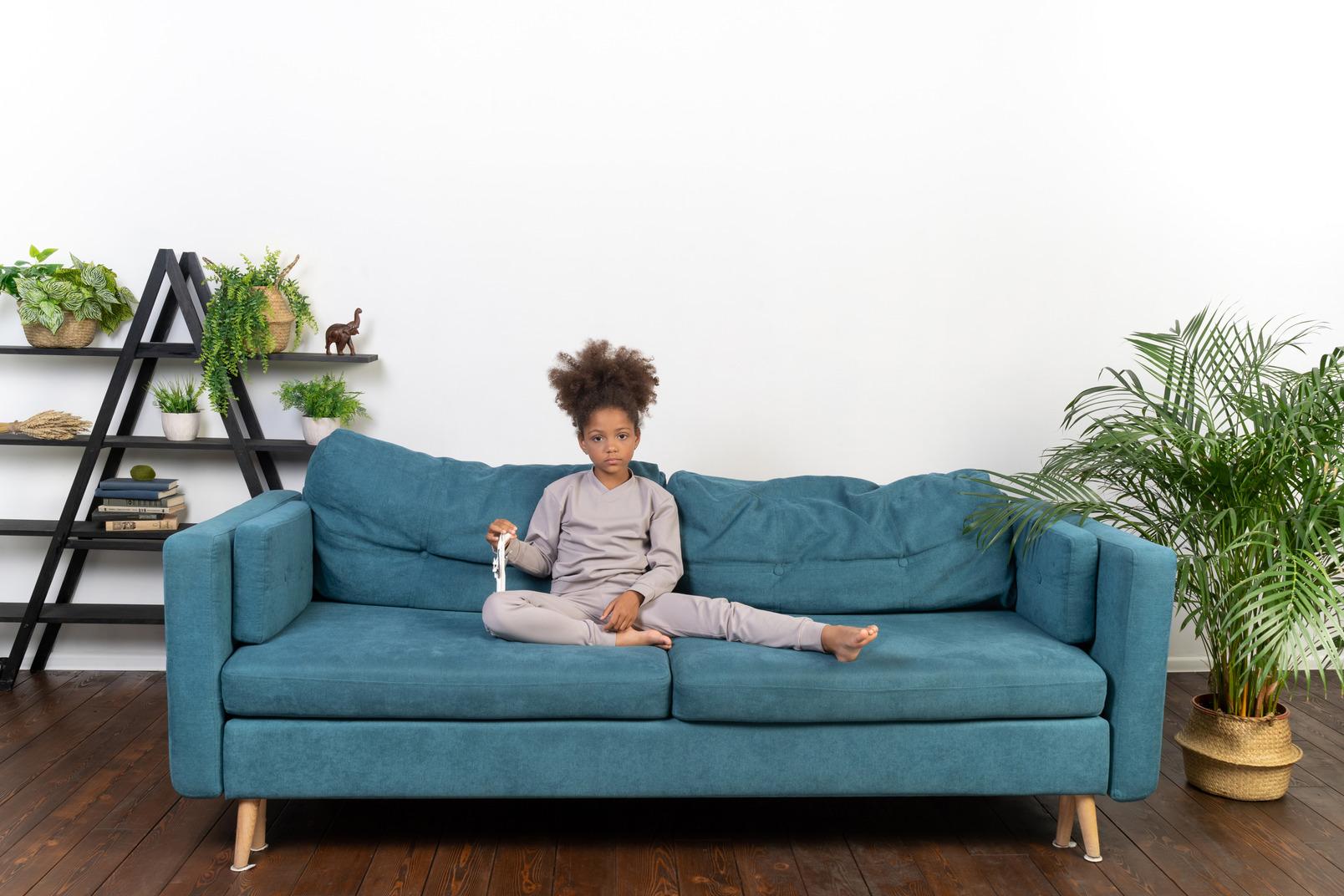 Cute girl on the sofa
