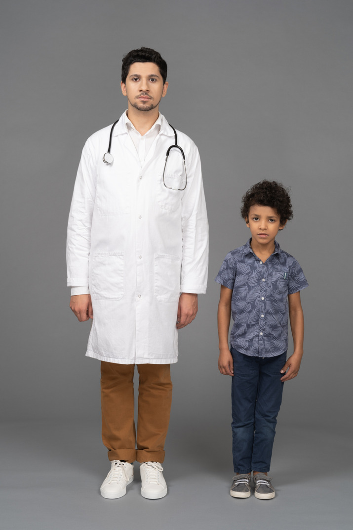 Doctor and boy standing still
