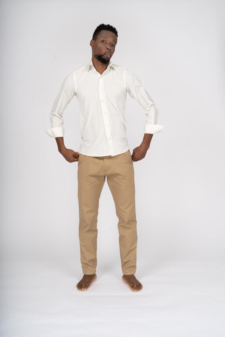 Man in white shirt standing