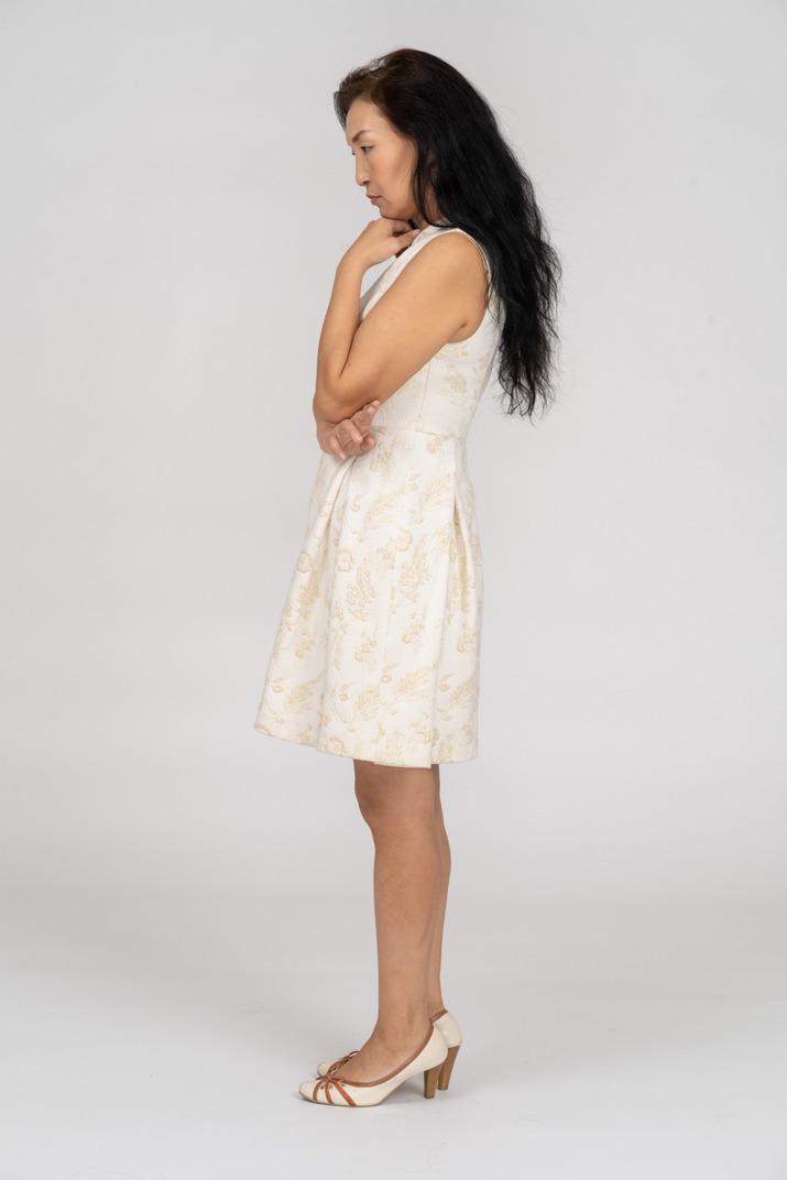 Woman in beautiful dress standing